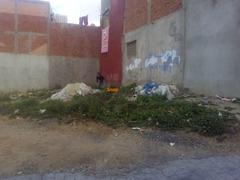 ارض محفضة 250م للبيع بواجهتين في حي بوبانا